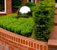 water feature globe in small front garden