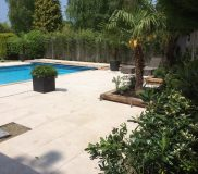 restored swimming pool with paving